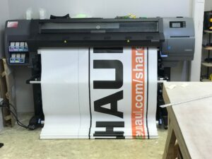 Banner Coming Off of Printer for Fabrication